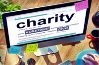 "A computer monitor displaying the word ""charity"""
