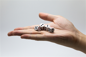Person's hand holding several dice that are about to be rolled