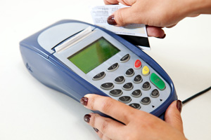 A credit card being processed through a terminal