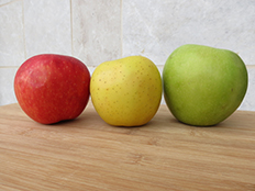 Three differently-colored apples