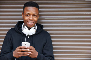 A teen with a smartphone