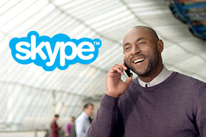 Man talking on phone using Skype