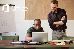 Men collaborating with Office 2016 on a laptop