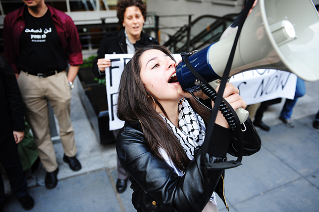 A woman speaking into a megaphone